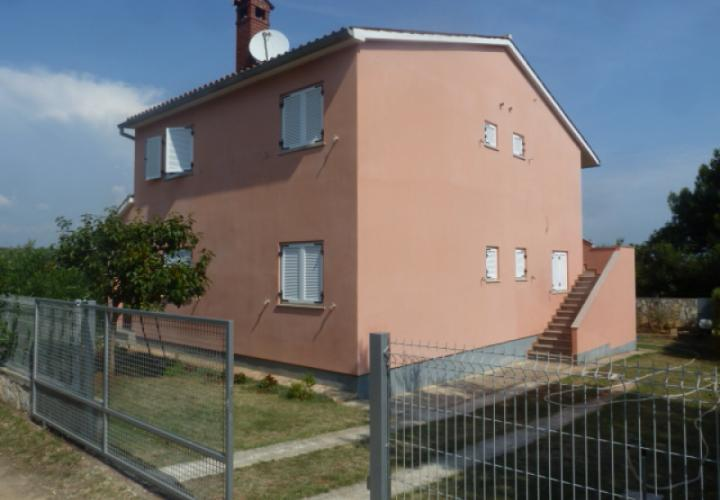 Lovely house for sale in Peroj with 3 apartments