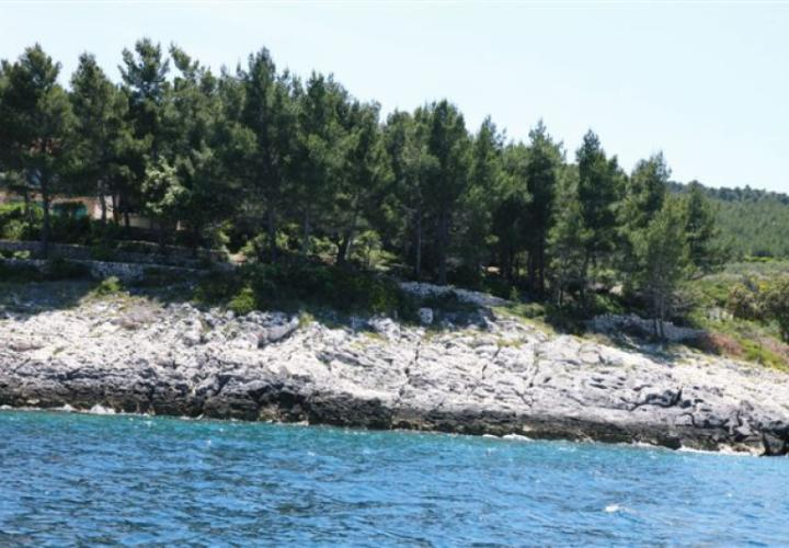 Waterfront land plot for sale on Korcula island in Prigradica, with valid building permit for lux villa, with mooring possibility for a yacht
