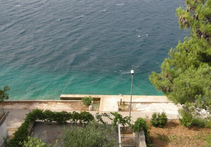 Beachfront building with three apartments in Primosten area